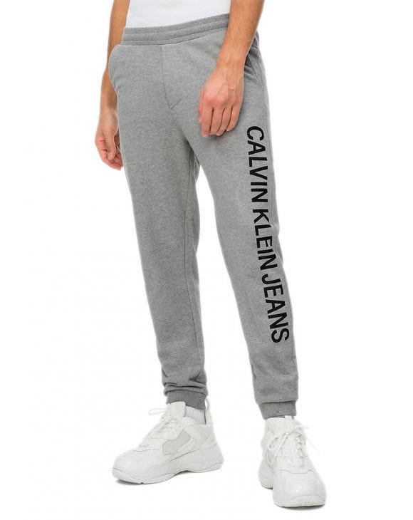 CK INSTITUTIONAL SIDE SWEATPANTS IN GREY
