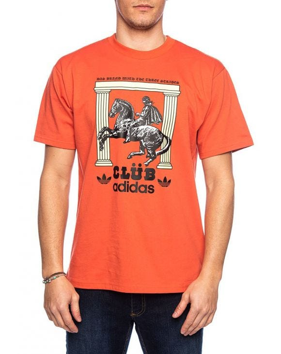 CLUBPILLARSTEE T-SHIRT IN ORANGE