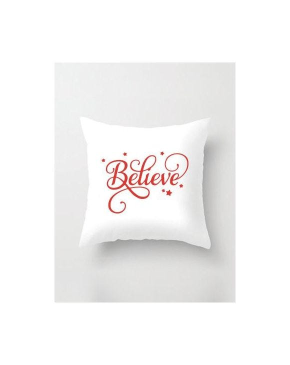RED BELIEVE PILLOW IN WHITE