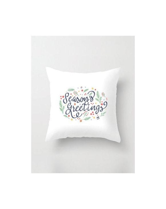 SEASON'S GREETINGS PILLOW IN WHITE